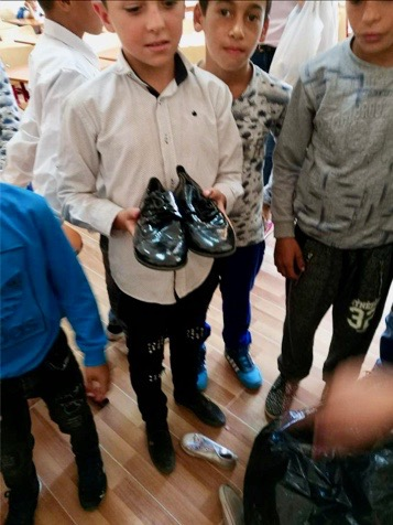Children in Caracal receiving their shoes.